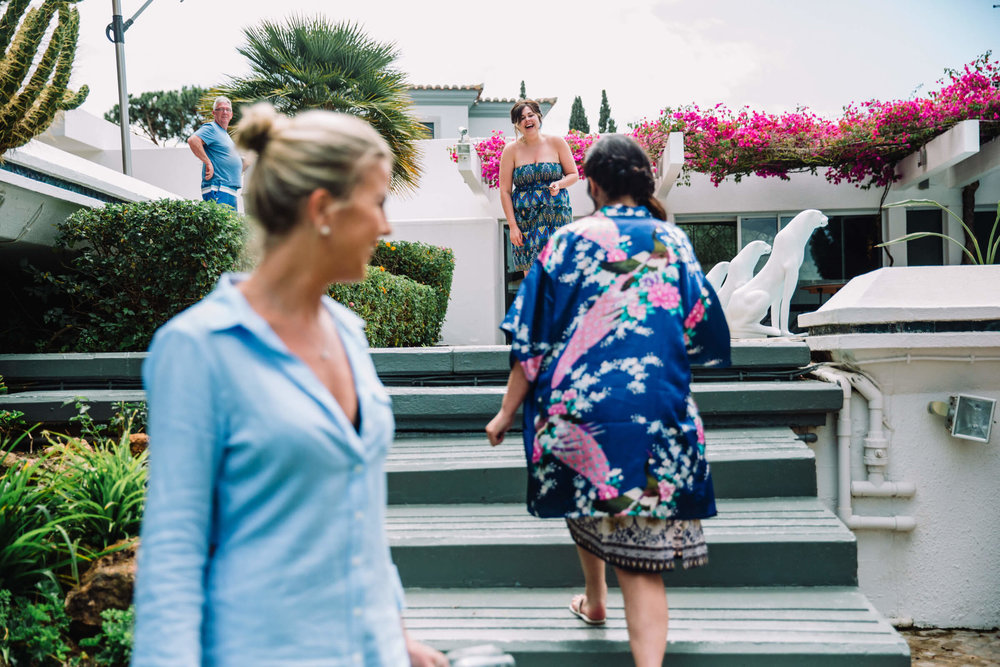 bridesmaids walking down steps and laughing