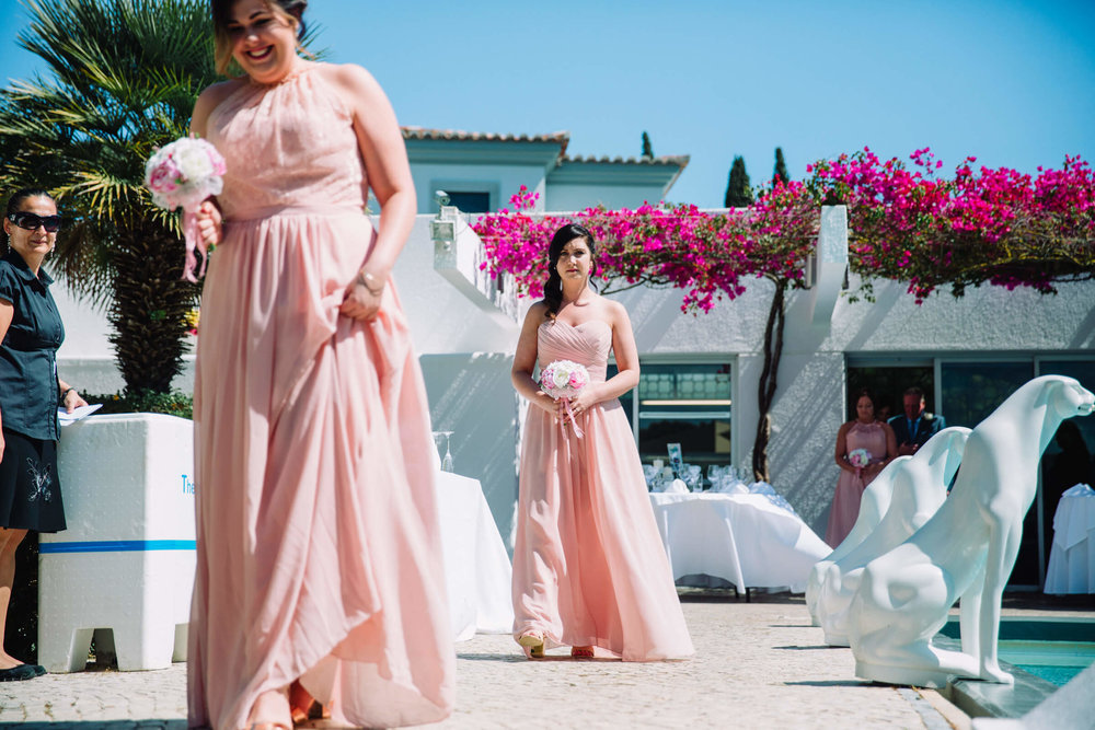 bridesmaids walking down aisle for wedding in Portugal