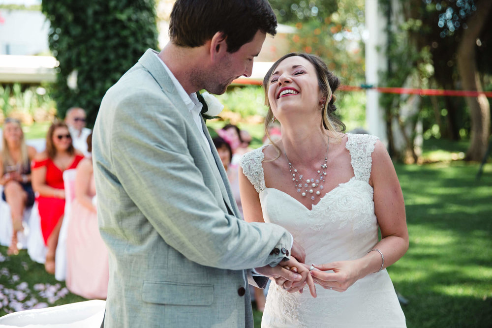bride laughing with groom during ceremony