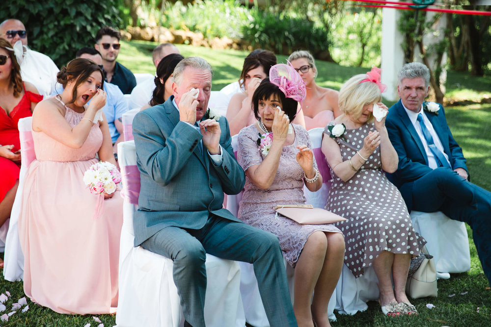 bridal party crying after ceremony finishes