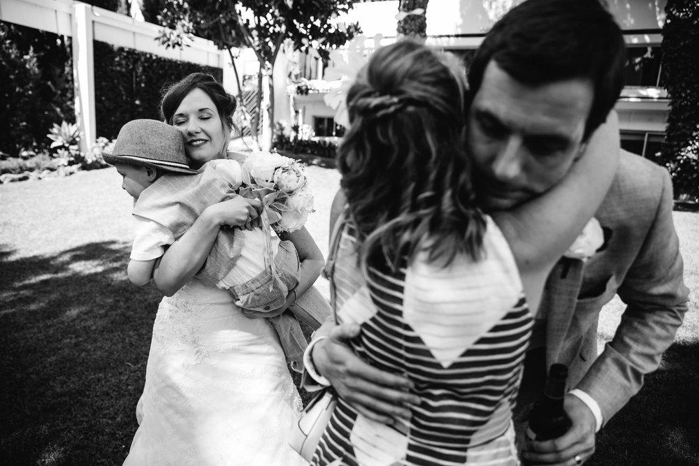 newlyweds hug guests