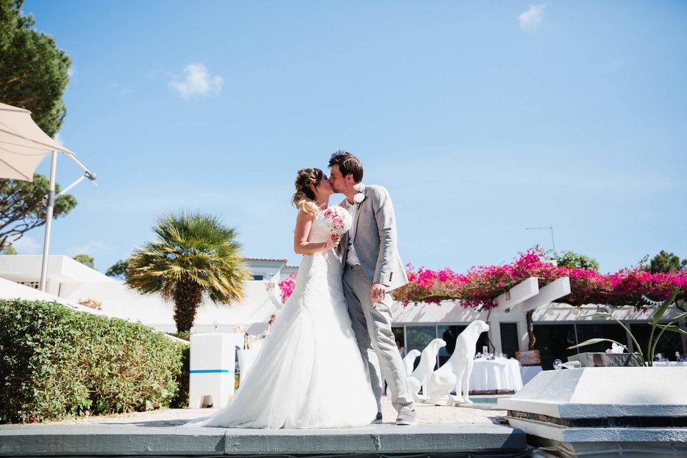 bride and groom portrait by the pool at vilamarques