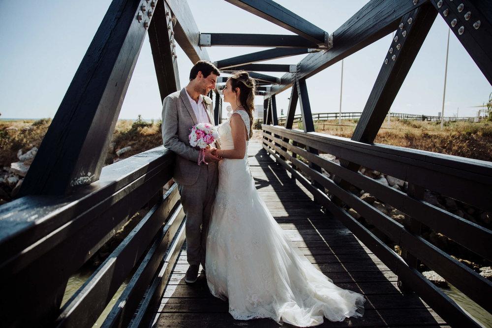 bride and groom on bridge for wedding at praia da falesia vilamoura