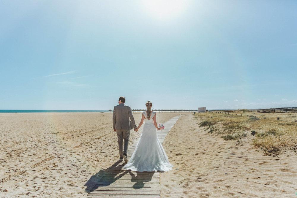 newlyweds at tivoli hotel marina for wedding beach portraits