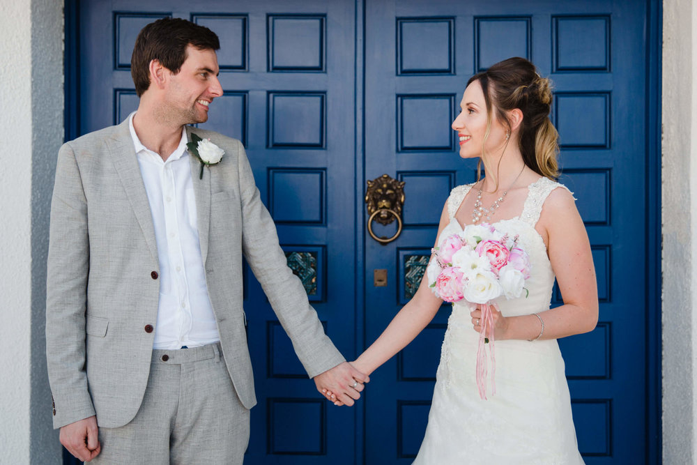 loving married couple hand in hand in doorway of vilamarques wedding