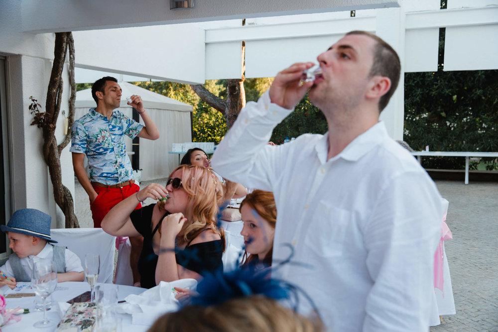 alcoholic shots being taken as part of best man speech
