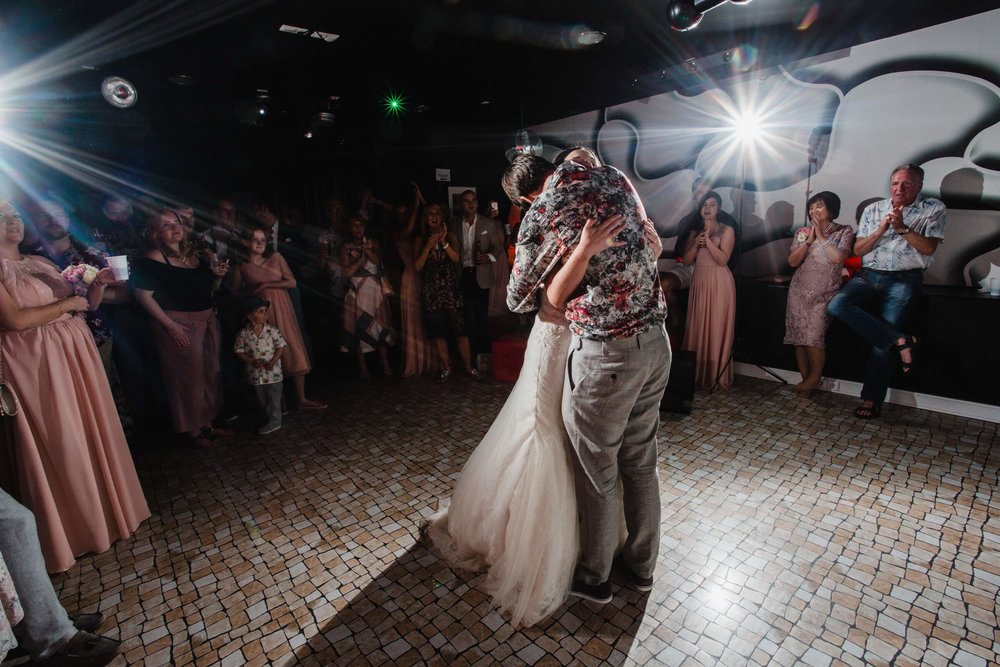 intimate hug on dance floor