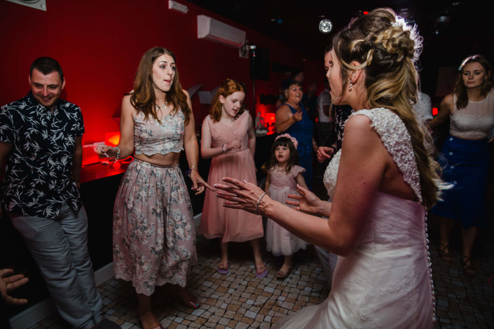 bridal party partying on dance floor