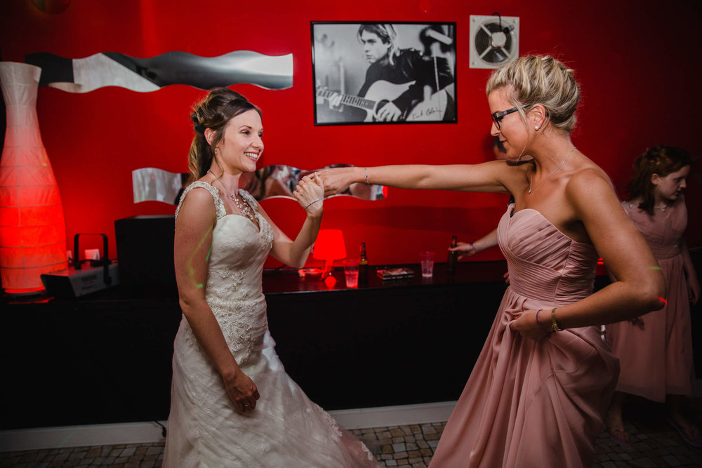 bride and bridesmaid having fun together on the dancefloor