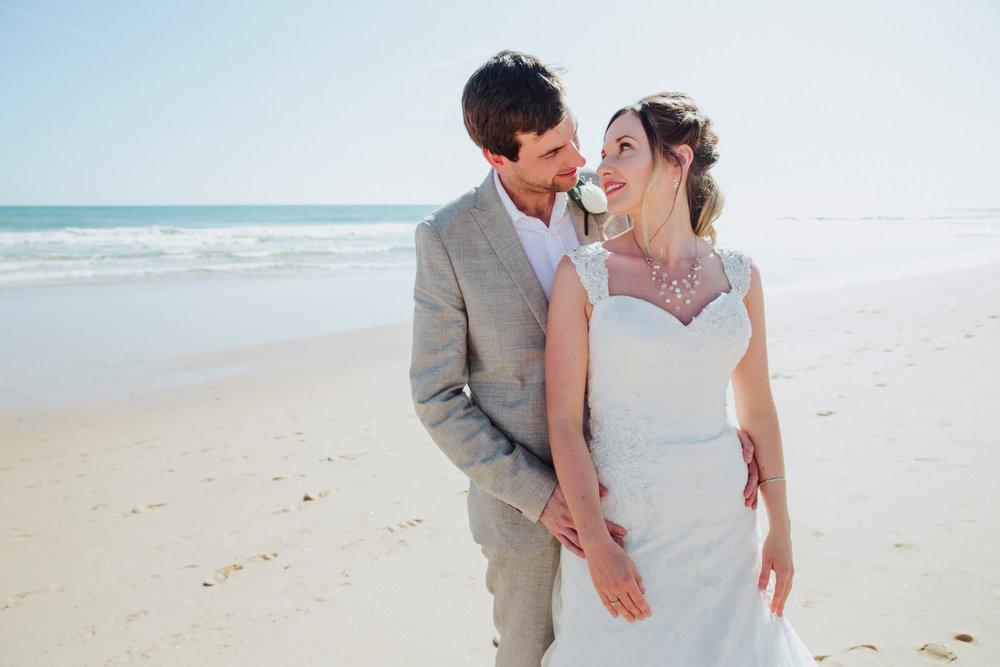 bride and groom portrait on praia da falesia beach