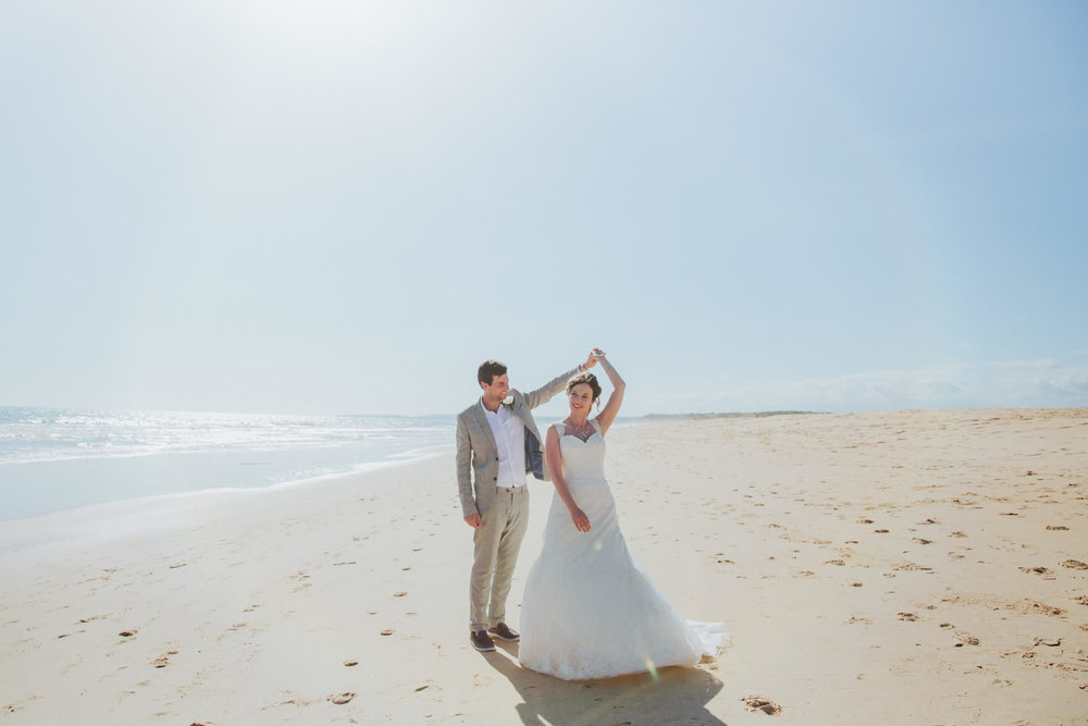 newlyweds dancing on vilamoura beach beside the marina