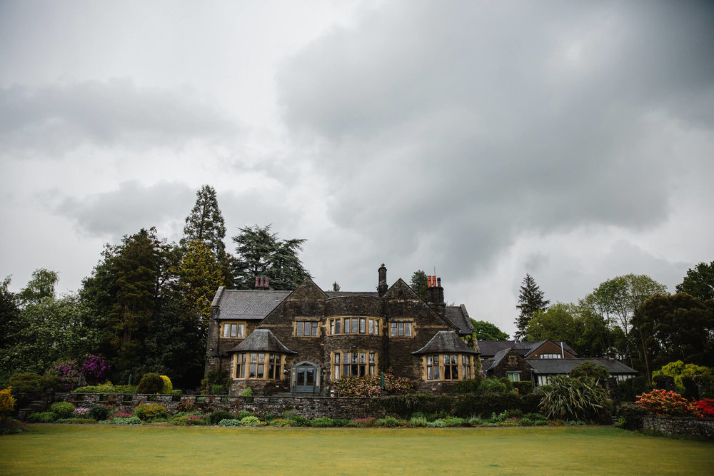 grey rain clouds looming above cragwood house