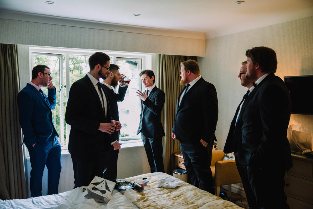 groom and ushers getting ready in room