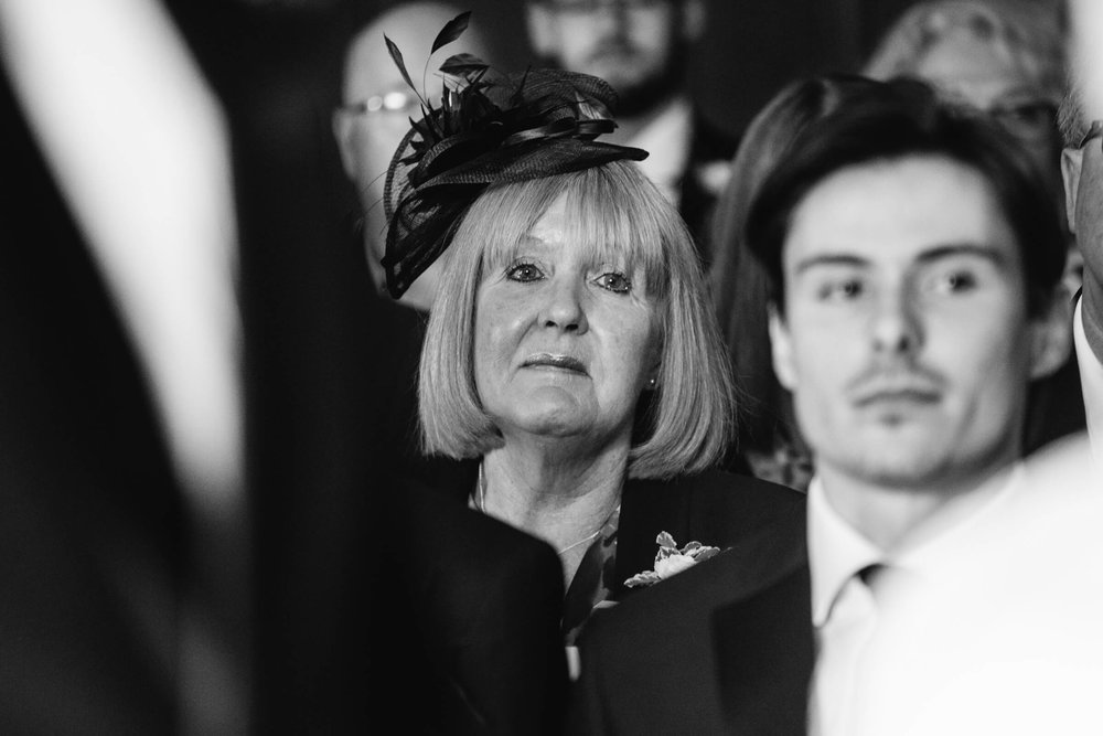 black and white close up photograph of the mother of bride looking on
