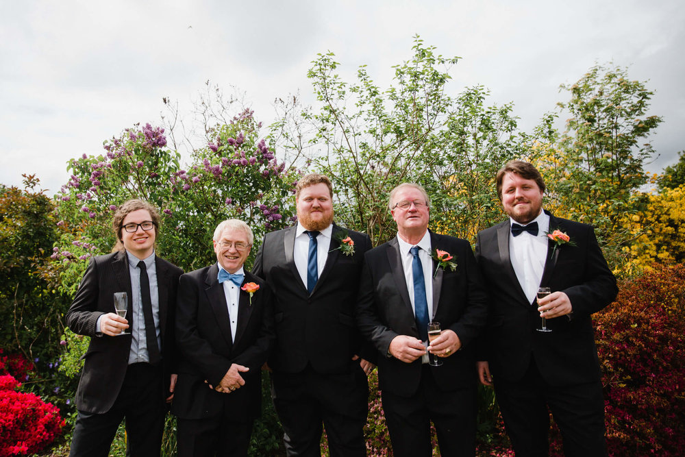 groom with friends laughing