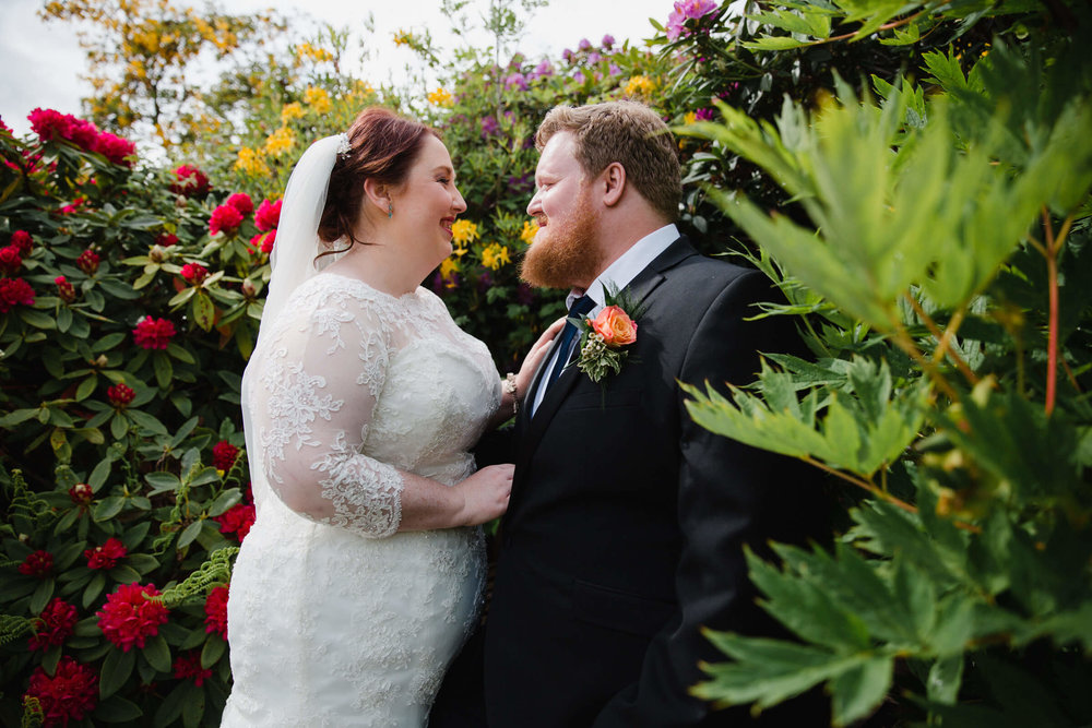 newlyweds portrait in the gardens of cragwood hotel