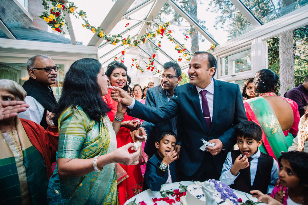 mother receives cake from groom