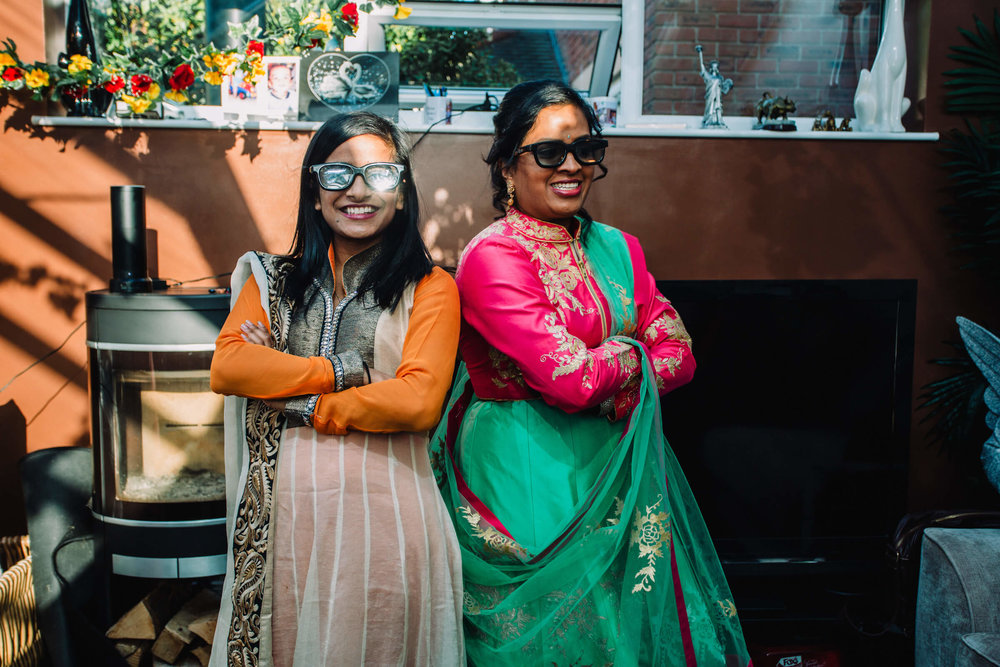 bridesmaids wearing black glasses and posing for the photograph