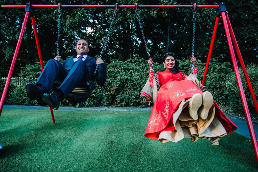 newlywed portrait on playground swings