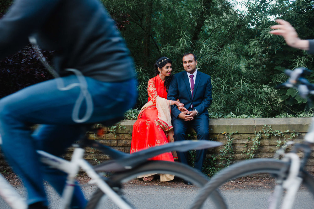 cyclists riding past married couple on bikes and signalling congratulations