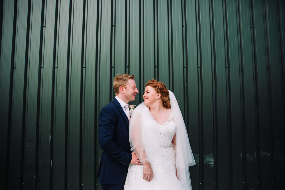 "<a href=""https://www.mcgowanweddings.co.uk/blogoriginal/2017/10/14/delamere-forest-wedding-photography-elizabeth-and-david"" target=""_blank"">CORRUGATED BACKDROPS! - LIZ AND DAVID'S DELAMERE WEDDING</a>"