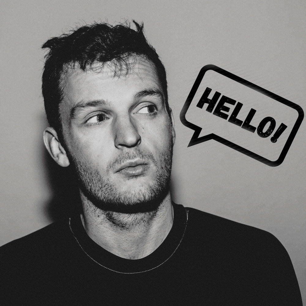 Title portrait image of Manchester Wedding Photographer Stephen McGowan displaying Hello speech bubble for new visitors to the website.