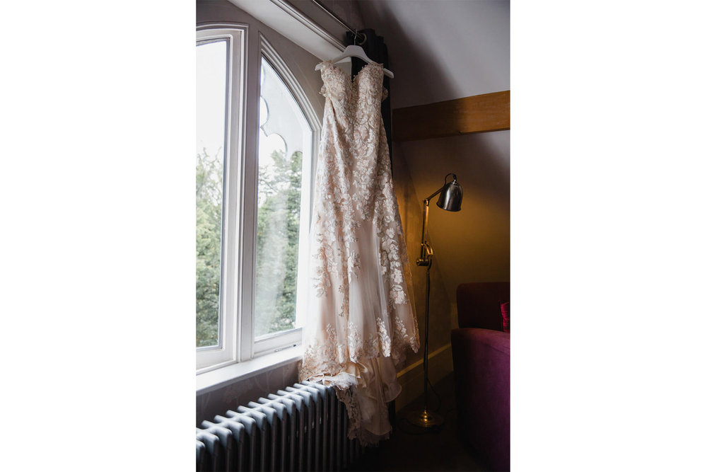 Justin Alexander Wedding Dress hung up in window