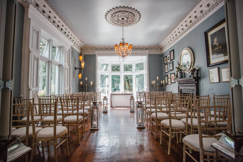 wide angle of the blue wedding ceremony room at eleven didsbury park hotel