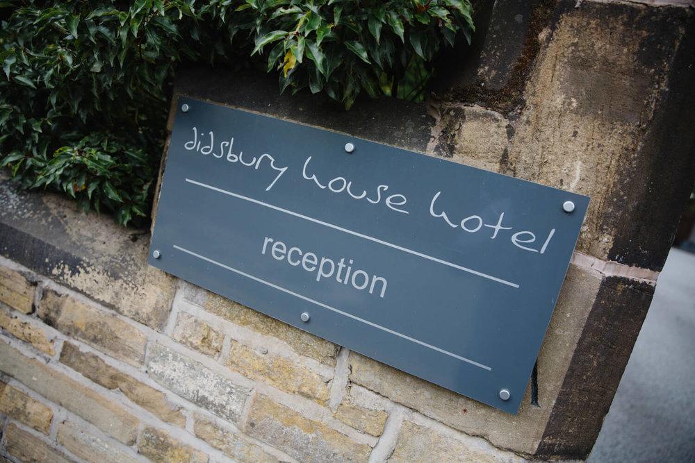 Entrance sign of Eleven didsbury park hotel wedding venue