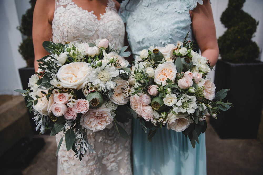close up of flower bouquets held by the bridal party