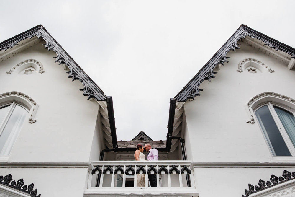 newly married couple portraits on the balcony of eleven didsbury park hotel