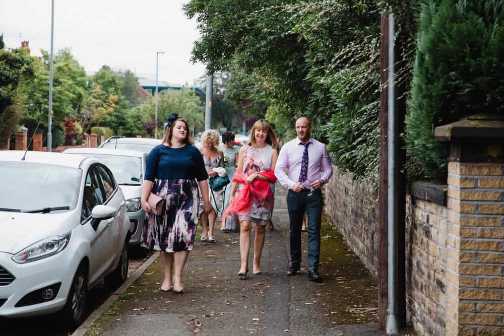 guests walking down the road to eleven didsbury park hotel