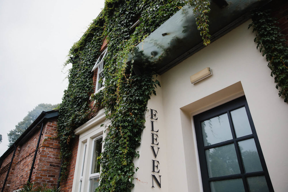 detail outdoor photograph of eleven didsbury house hotel with ivy running up walls