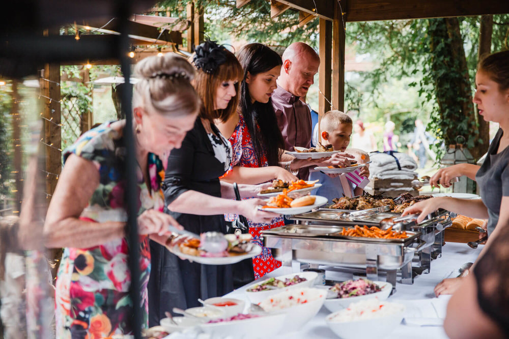 guests collecting food from the bbq buffet table