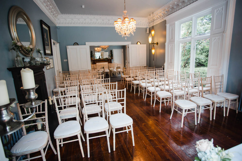 photograph of ceremony room taken from the front of the aisle looking to the back wall
