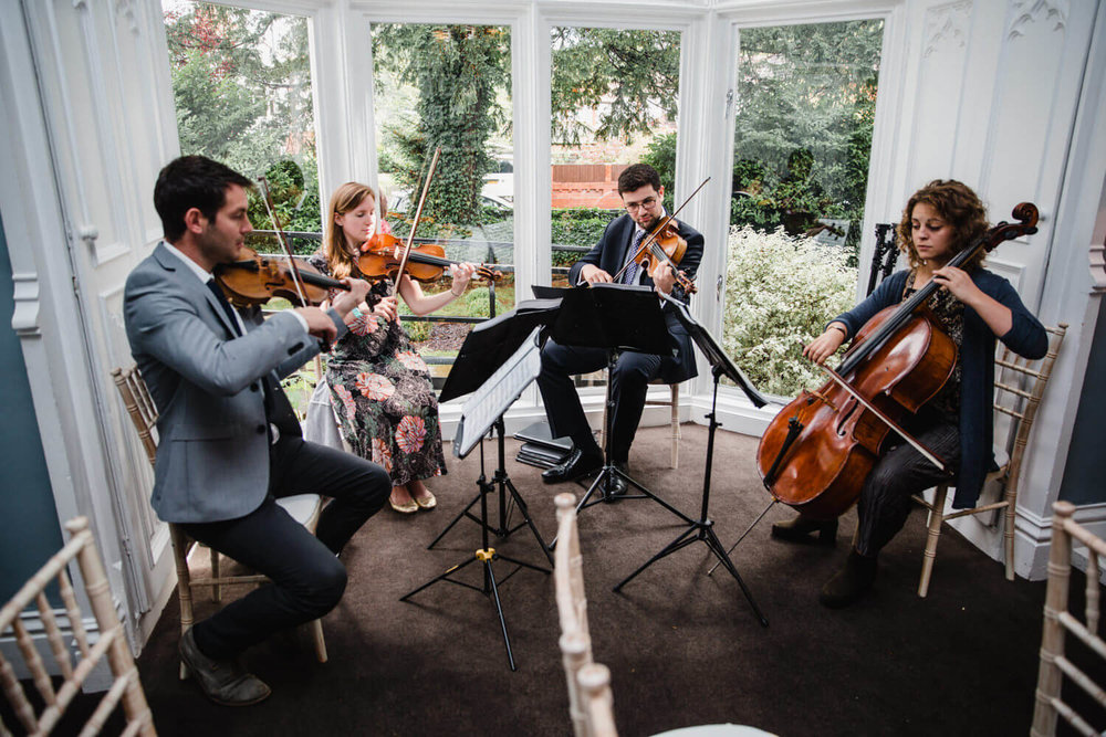 String Quartet playing music to guests before the wedding ceremony