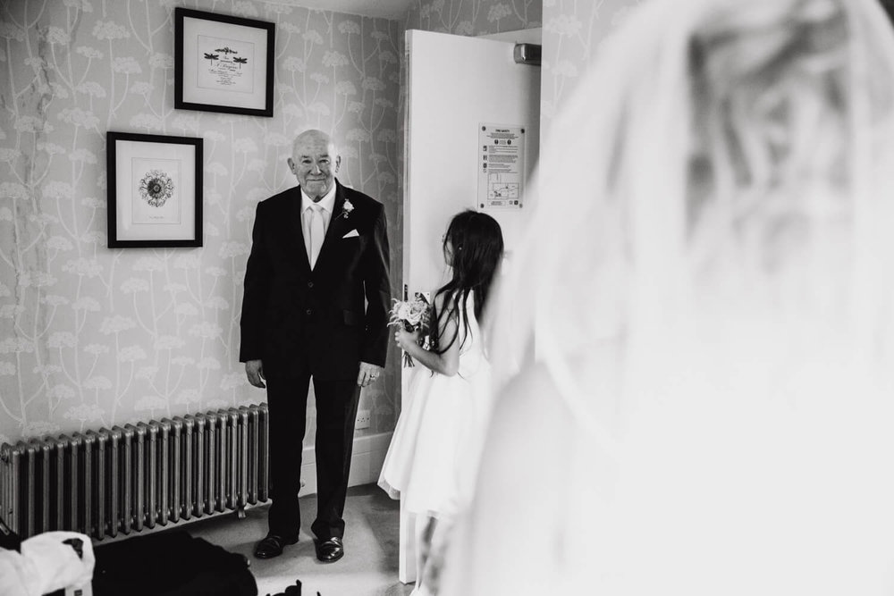 first look from the father of the bride to his daughter before the wedding ceremony
