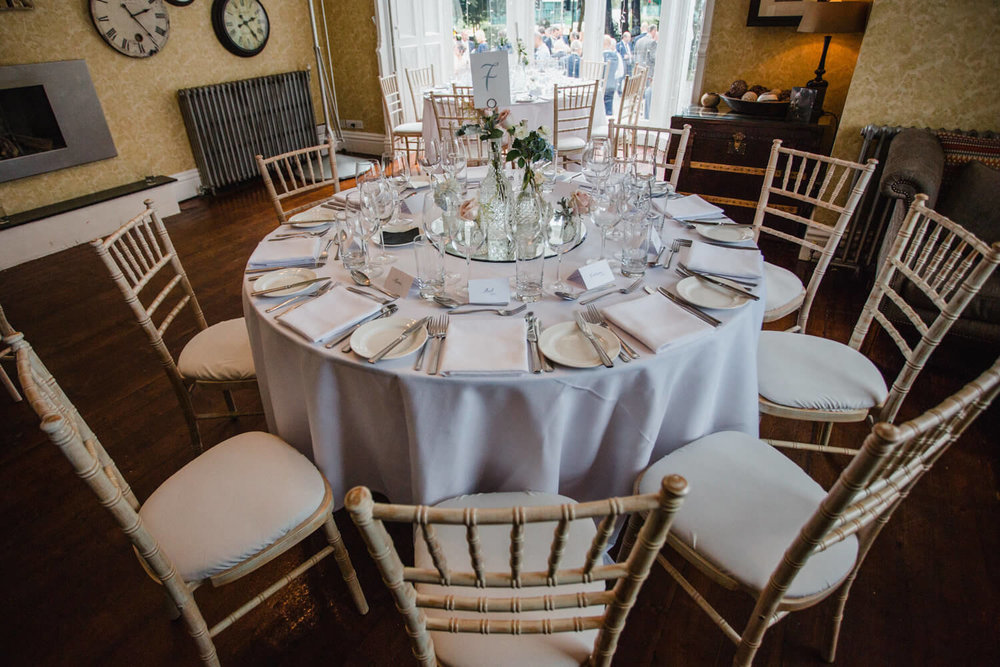 wedding breakfast table with chiavari chairs and decorative table furnishings