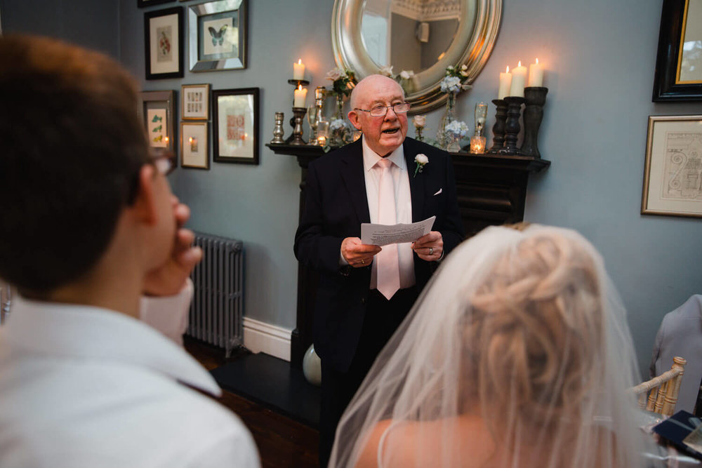 father of bride giving his speech to the wedding party