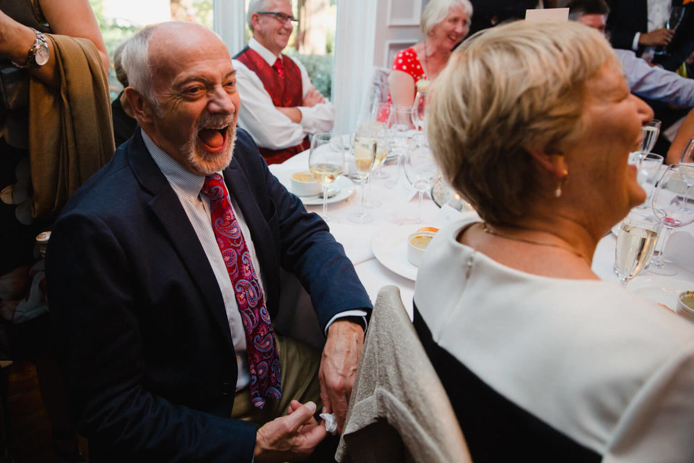 Wedding guest laughing at speeches