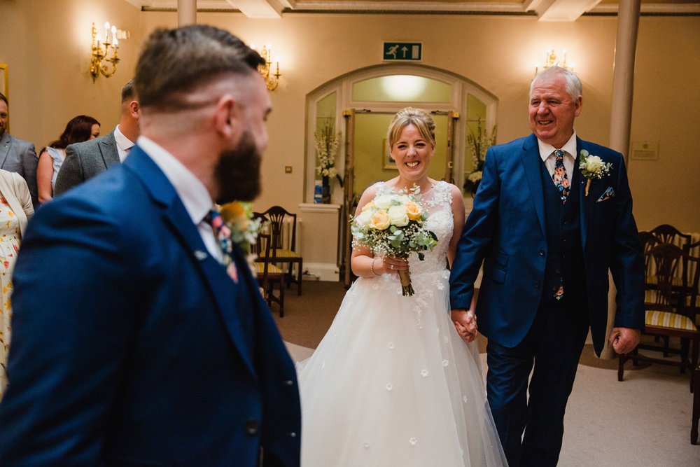 bride and groom first look during stockport town hall wedding ceremony