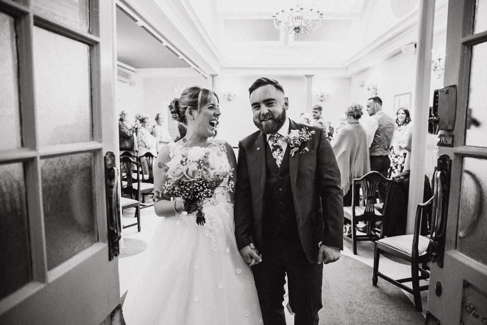 Newlyweds celebrating after wedding ceremony