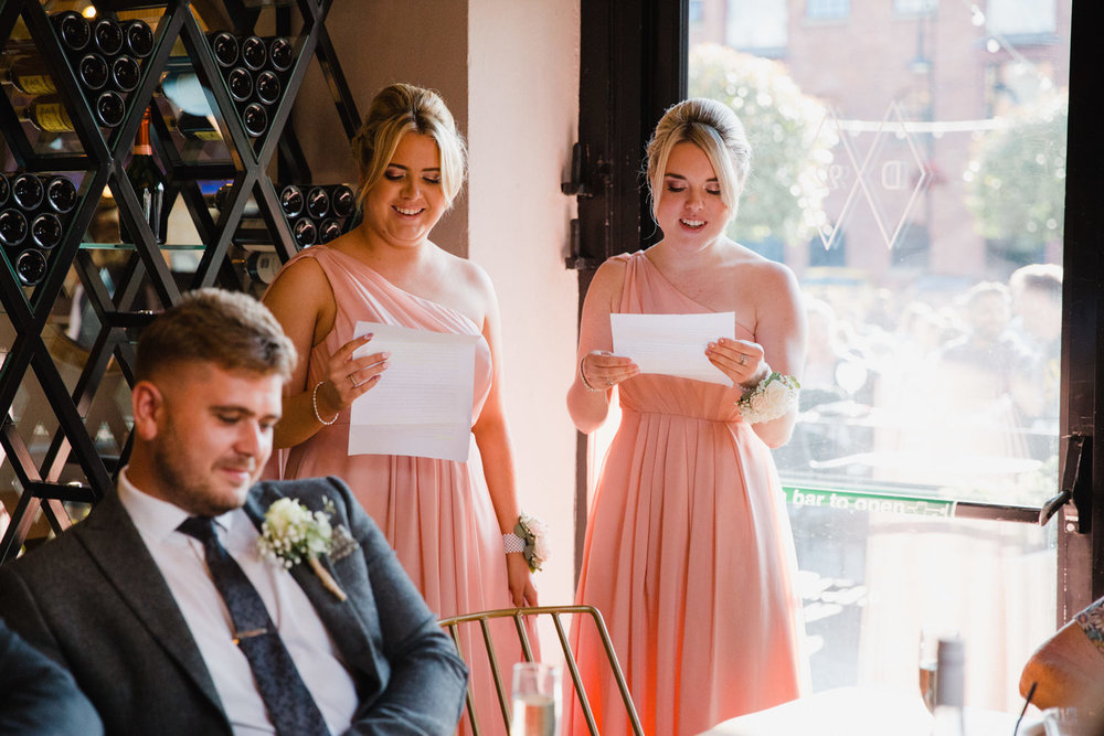 bridesmaids giving a joint speech to wedding party
