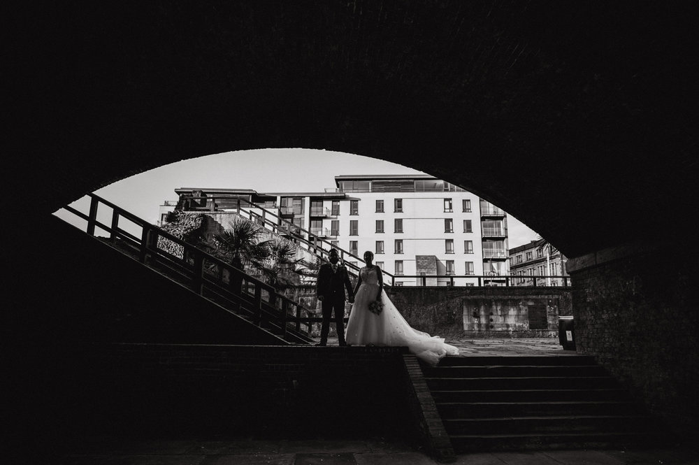silhouette photograph in black and white of the bride and groom under an archway in castlefield