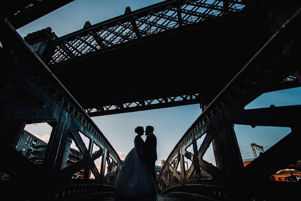 silhouette photograph of married couple on bride in castlefield deansgate