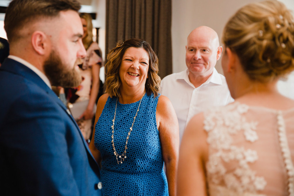 wedding guest sharing a joke with bride and groom at the castlefield rooms