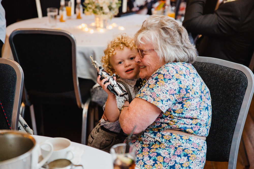 pageboy sharing an intimate cuddle with grandma