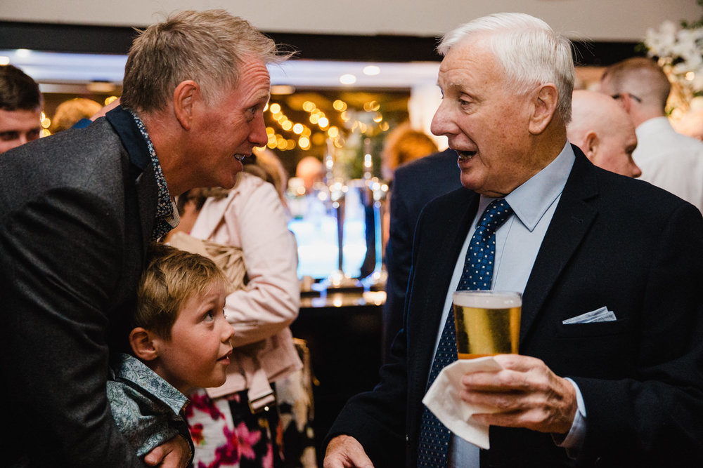 father and son chatting with granddad over drinks at the castlefield rooms