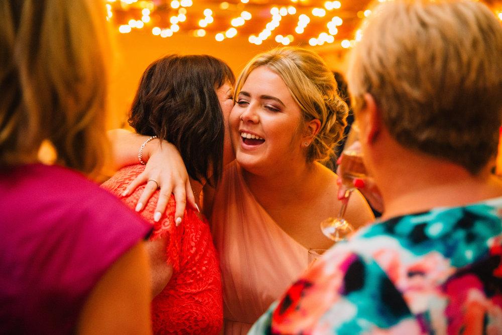 bridesmaid hugging wedding guests at the wedding reception in castlefield
