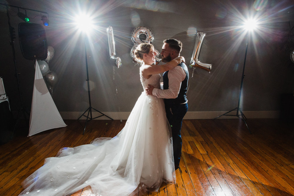 newlyweds first dance together on the main floor at their castlefield wedding